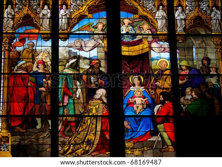 Epiphany - Adoration of the Magi - Church window in Dom of Cologne - christian feast celebrated on 6 January - stock photo