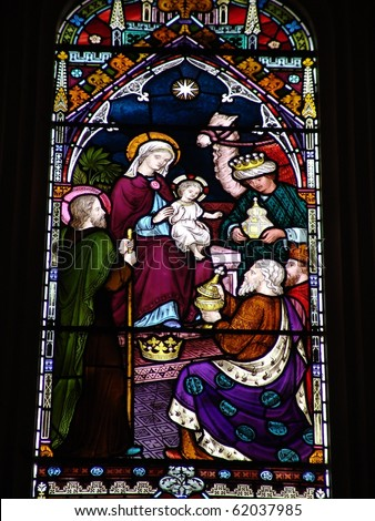 Epiphany scene on stained glass window - stock photo