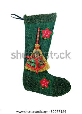 Epiphany sock decorated with broom and old woman's face.In Italian tradition an old woman (called Befana) fills socks with sweets for good children and with coal for bad ones on the 5/6 January night - stock photo