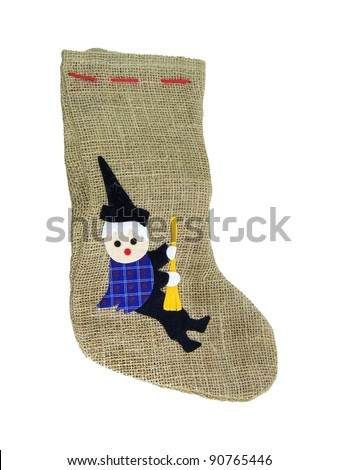 Epiphany sock decorated with old woman riding broom..In Italian tradition an old woman (called Befana) fills socks with sweets for good children and with coal for bad ones on the 5/6 January night - stock photo