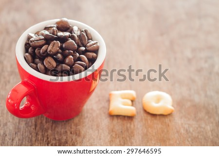 EQ alphabet biscuit with red coffee cup, stock photo - stock photo
