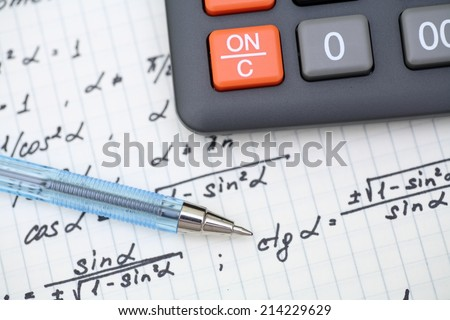 Equations close-up. Homework. Solving Mathematical Problem. Focus on pen. - stock photo