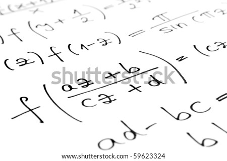Equations on a sheet of paper - stock photo