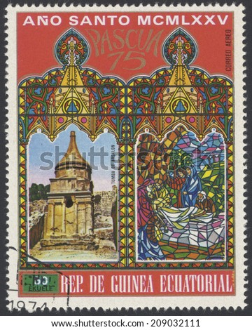 EQUATORIAL GUINEA - CIRCA 1975: A stamp printed in Equatorial Guinea, shows Chapel of the Ascension (Jerusalem) and Jesus Christ with a Cross, circa 1975 - stock photo