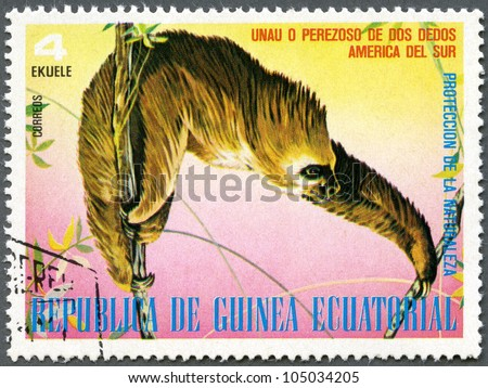 EQUATORIAL GUINEA - CIRCA 1977: A stamp printed in Equatorial Guinea, shows Sloth, series South American Animals, circa 1977 - stock photo