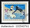 EQUATORIAL GUINEA - CIRCA 1976: A stamp printed in Equatorial Guinea shows sportsmen playing soccer football. Summer Olympics, Montreal, airmail. Scott Catalog 76146-76151 200e gold blue, circa 1976 - stock photo