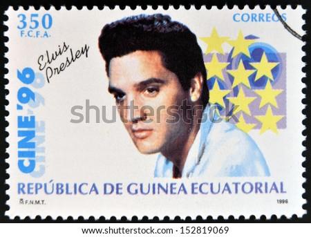 EQUATORIAL GUINEA - CIRCA 1996: A Stamp printed in Guinea dedicated to cinema shows Elvis Presley, circa 1996 - stock photo