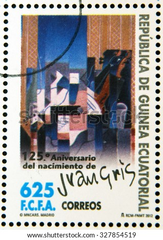EQUATORIAL GUINEA - CIRCA 2012: A stamp printed in Guinea dedicated to 125th anniversary of the birth of Juan Gris, shows violin and guitar, circa 2012  - stock photo