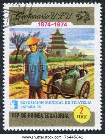 EQUATORIAL GUINEA - CIRCA 1974: A stamp printed in the Equatorial Guinea, is devoted to the philately exhibition in Spain-75, shows the Chinese postman, circa 1974 - stock photo
