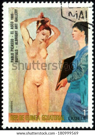"EQUATORIAL GUINEA - CIRCA 1975: A stamp printed in the Equatorial Guinea, is shown painting Pablo Picasso ""El Aseo"", circa 1975 - stock photo"