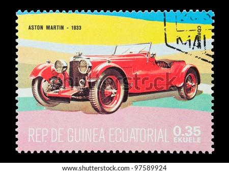 EQUATORIAL GUINEA - CIRCA 1974: Mail stamp printed in Equatorial Guinea featuring a vintage 1933 Aston Martin sports car, circa 1974 - stock photo