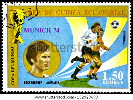 "EQUATORIAL GUINEA - CIRCA 1974: stamp printed in Equatorial Guinea shows football players and portrait of Beckenbauer, Germany, inscription and series ""Football World Cup, 1974, Munich"", circa 1974 - stock photo"
