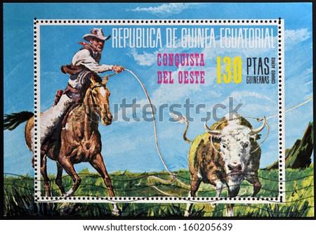 EQUATORIAL GUINEA - CIRCA 1976: stamp printed in Equatorial Guinea, shows the conquest of the West, circa 1976  - stock photo