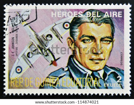 EQUATORIAL GUINEA - CIRCA 1974: stamp printed in Guinea dedicated to air heroes, shows J. E. Johnson, historic aviator of the Second World War, circa 1974