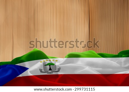 Equatorial Guinea flag and wood background