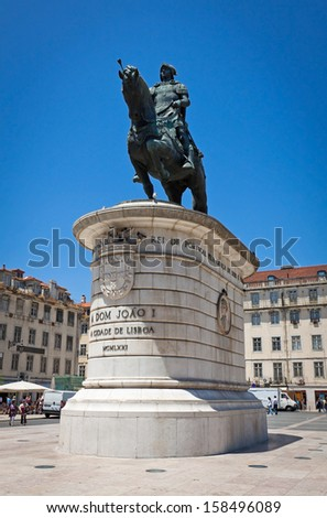 Equestrian bronze statue of Dom Joao I, also known as John I of Portugal, located in Figueira Square in Lisbon, Portugal - stock photo