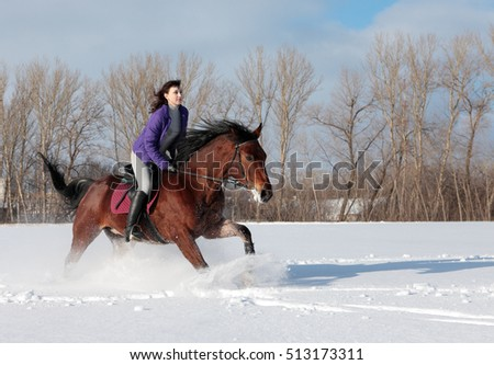 Equestrian model ride horseback through the snow fields