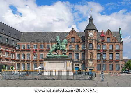 Equestrian monument of Johann Wilhelm II (Jan Wellem) and Old Town Hall of Dusseldorf, Germany. The monument was erected in 1711. The oldest wing of the Town Hall was built in 1570-1573. - stock photo