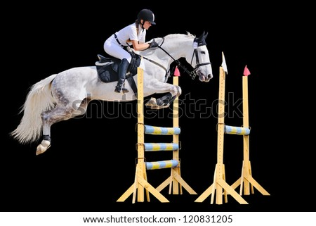 Equestrian sport: young girl in jumping show (isolated on black) - stock photo