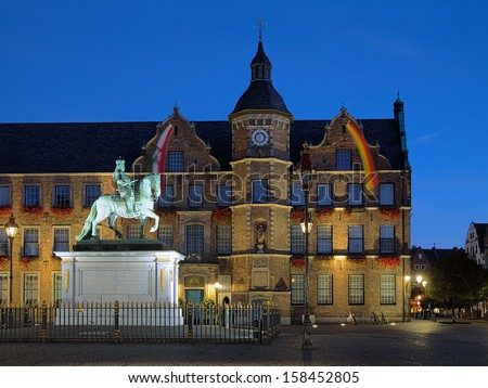 Equestrian statue of Johann Wilhelm II (Jan Wellem) and City Hall of Dusseldorf at dawn, Germany - stock photo