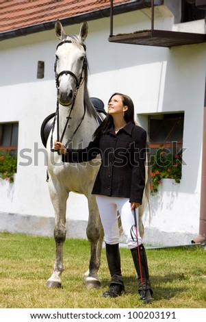 equestrian with horse - stock photo