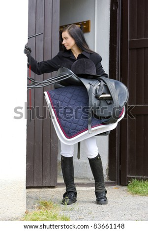 equestrian with saddle - stock photo