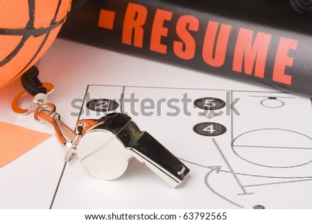 Equipment and a resume of a very experienced basketball coach. - stock photo