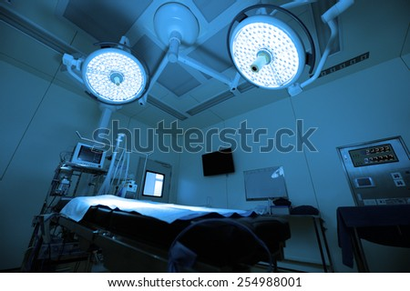 equipment and medical devices in modern operating room operation room take with blue filter - stock photo
