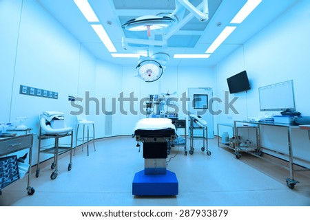 equipment and medical devices in modern operating room take with blue filter - stock photo