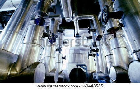 Equipment, cables and piping as found inside of a modern industrial paper plant        - stock photo