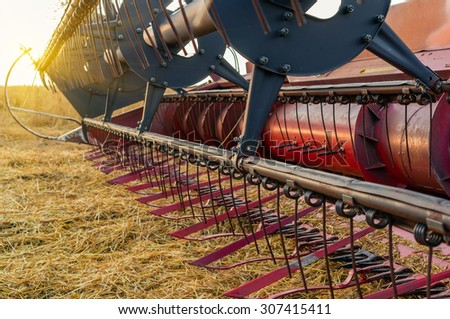 Equipment for agriculture, close-up view of the front of a combine harvester - stock photo