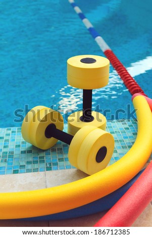 Equipment for Aqua Aerobics in the pool - stock photo