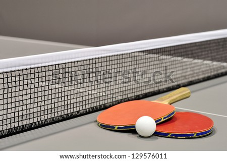 Equipment for table tennis - racket, ball, table closeup - stock photo