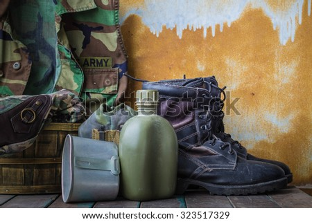 Equipment for the departure of the troops on the wooden floor. - stock photo