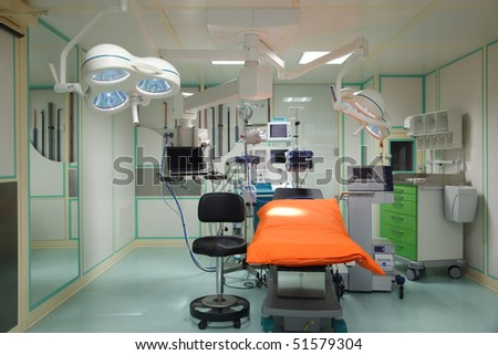 Equipment for the operating room. Special lamps, monitor and desk. - stock photo