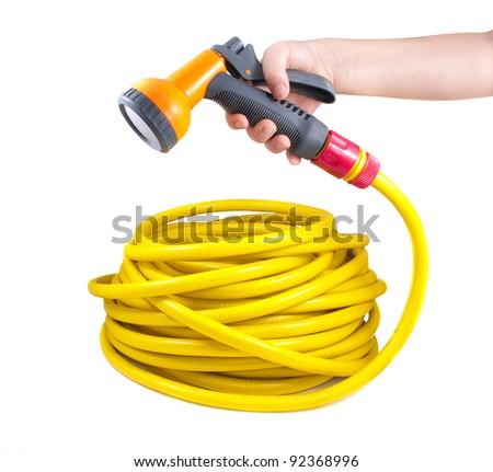 Equipment for watering garden. Hose and spray gun isolated on white background - stock photo