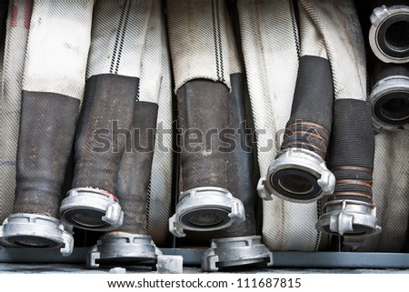 Equipment of fire truck. Hoses. - stock photo