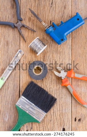 Equipment of tool on wooden background. - stock photo