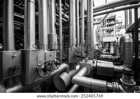 equipment, piping as found inside of a modern industrial petrochemical plant
