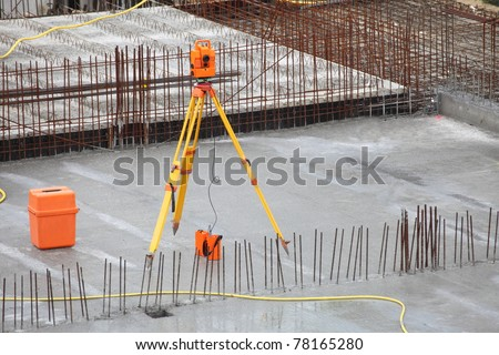 equipment theodolite tool at construction site works - stock photo