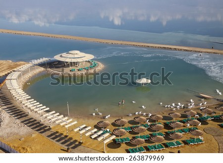 Equipped Beach on the shore of the Dead Sea - stock photo