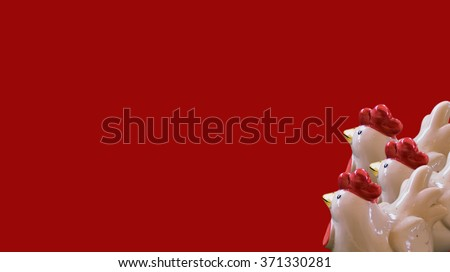eramic Chicken with red background,ceramic,old Ceramic, Ceramic Chicken,Decorative ceramic, Chicken with colorful ceramic shape,beautiful ceramic of thailand,doll on the floor - stock photo
