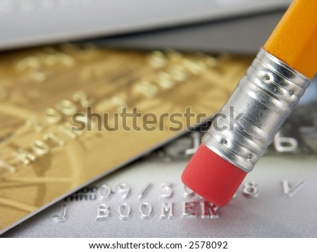 Erase credit card debt. - stock photo