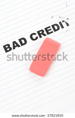 eraser and word bad credit, concept of making change - stock photo