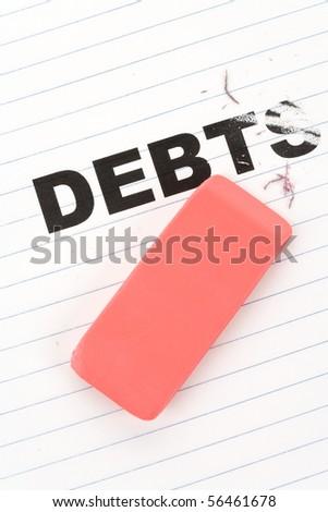 eraser and word debt, concept of Reduce Debt - stock photo