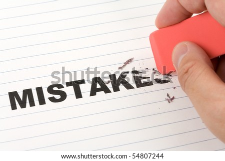 eraser and word mistakes, concept of Making Changing - stock photo