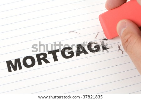 eraser and word mortgage, concept of Reduce Mortgage Debt - stock photo