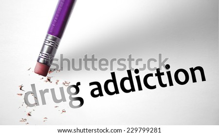 Eraser deleting the concept Drug Addiction - stock photo