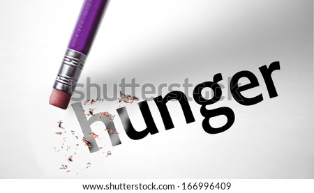 Eraser deleting the word Hunger - stock photo