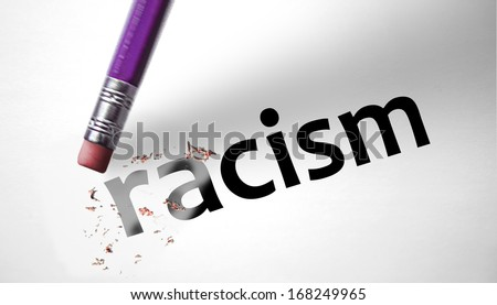 Eraser deleting the word Racism - stock photo
